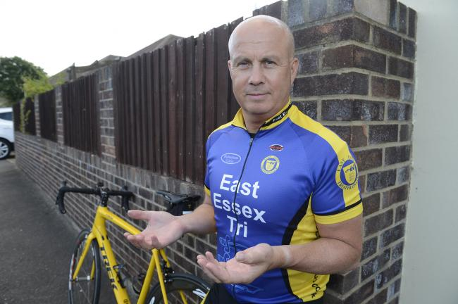 Injured - cyclist John Smith was thrown from his bike after a dog ran out in front of him
