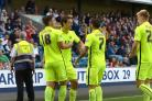 Celebration time - Southend United's players congratulate David Mooney on his goal