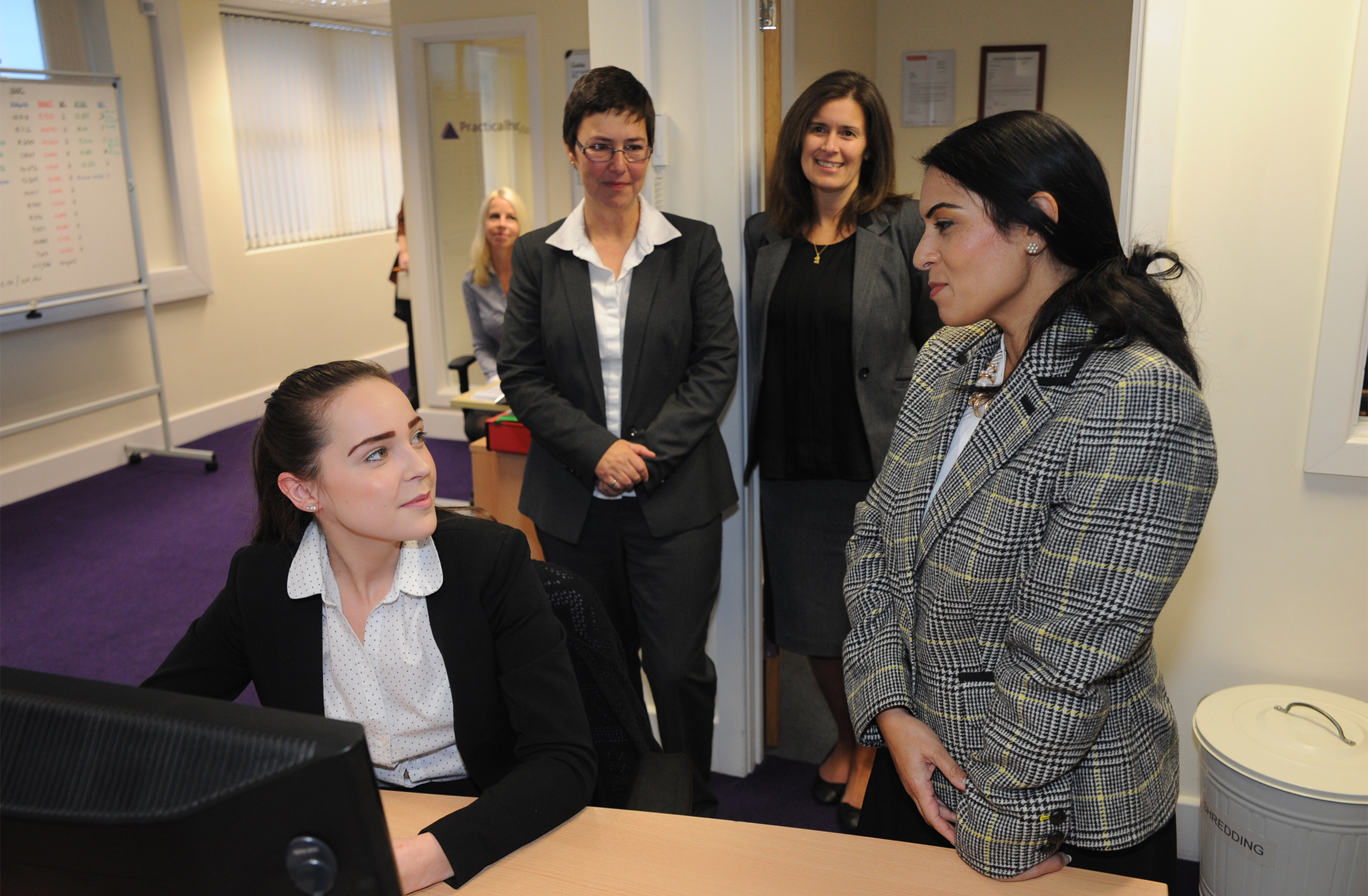 Just the job – Employment Minister Priti Patel chats with former apprentice Jasmine Aston as Practicalhr owner Paula Fisher and Fiona Haworth, senior HR consultant, look on