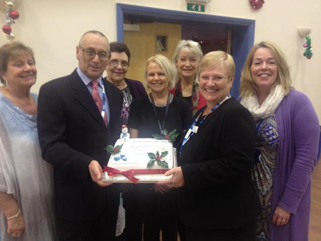Southend Hospital chairman Alan Tobias OBE holds a cake with chief  executive Sue Hardy, flanked