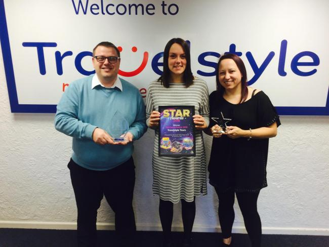 Winners – Travelstyle's Liam Fox with the Britannia award and Danielle Shuttleworth and Simone Thackray showing off the Merlin award