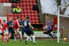 Adam Thompson heads home Southend's second goal of the game