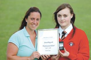 Rebecca Hayward, 14, takes the award, which is spelt incorrectly, from FitzWimarc teacher Lynne Kelly