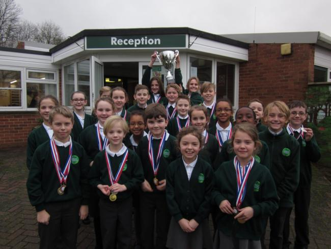 Winners - The Lincewood Primary School swimmers show off the trophy