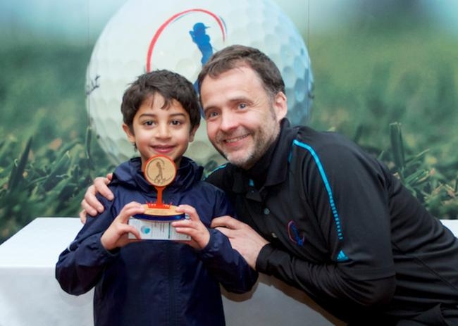 One for the future - Ali-Asgher Haji receives his award from British Junior Golf Tour director Steve Adams after winning the opening Super Six event    (Picture: BRITISH JUNIOR GOLF TOUR)