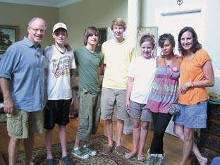 Meet the family – Ross, third left, lived with the Garnett family in Alabama and had to abide by their very strict ways