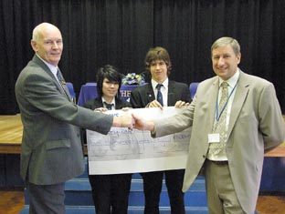 Handing over the cash – Rotarian Jim Robbins and headteacher Chris Hayes with pupils Heather Doherty and Kane Feathers