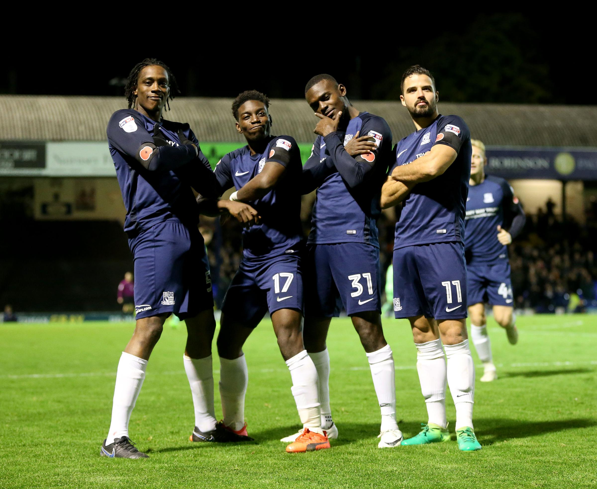 Celebration time - Theo Robinson celebrates his goal with his team-mates