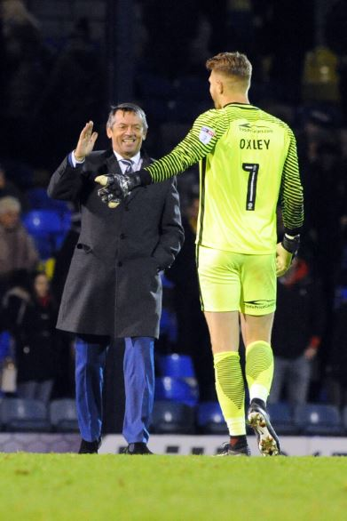 Congratulations - Phil Brown with goalkeeper Mark Oxley at the final whistle