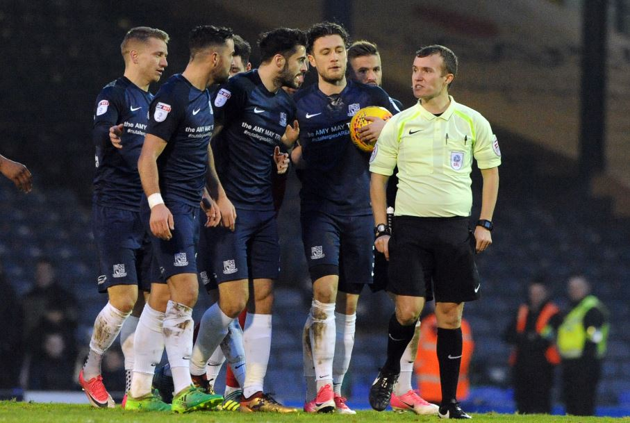 Frustration - Blues' players confront referee Antony Coggins