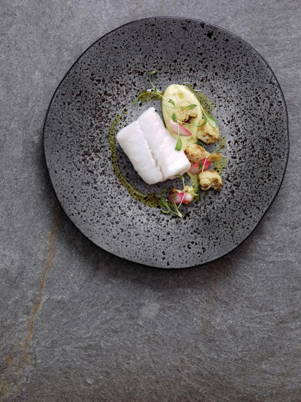 Echo: Undated Handout Photo of poached skrei cod with cauliflower purée and pickled radishes. See PA Feature FOOD Roux. Picture credit should read: PA Photo/Norwegian Seafood Council/Steve Lee. WARNING: This picture must only be used to accompany PA Feature FO