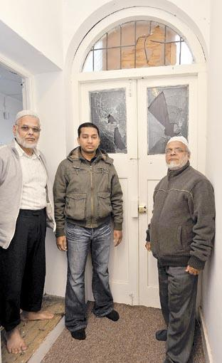 Shocked - Ghulm Faruque, Muhammed Kibria and Rafique Ahmed by the front door of imam Mahmudul Hasan's flat