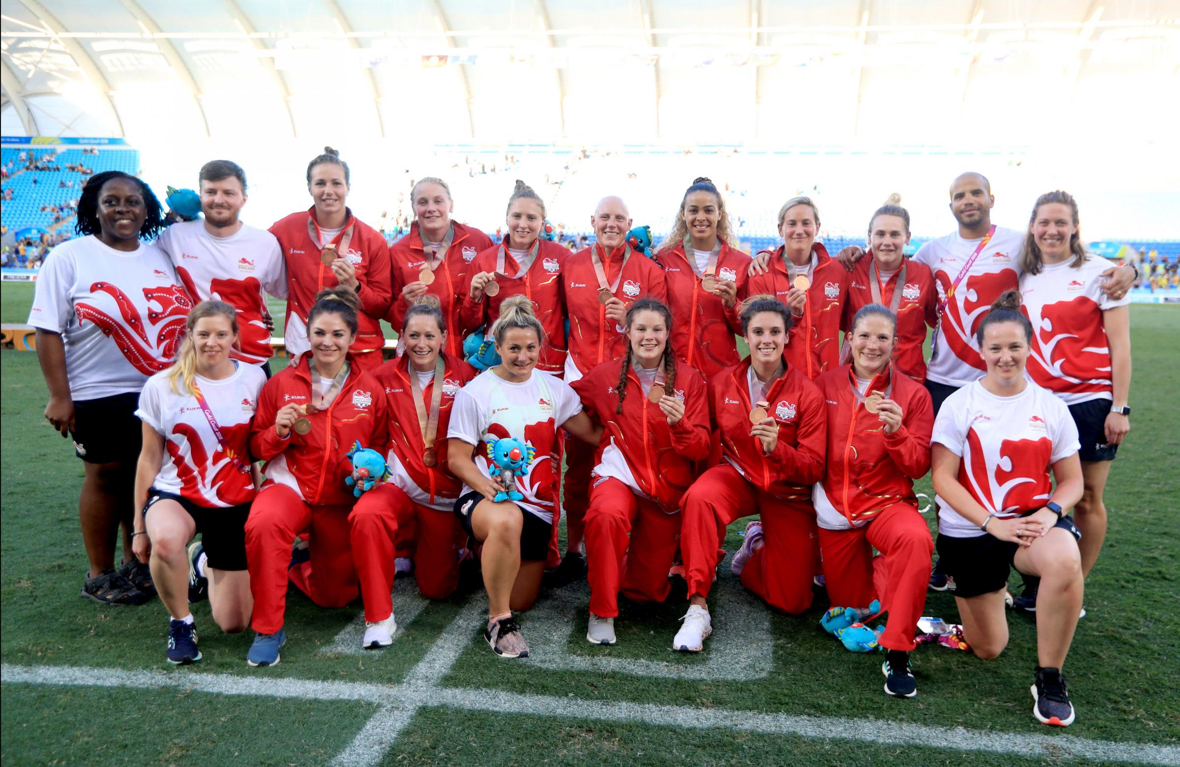 Bronze medallists - Emily Scott, five from left in the back row, and England's rugby sevens squad finished third on Australia's Gold Coast
