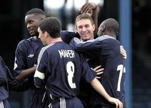 Broad grin — Southend players Leon Cort (left), Kevin Maher and Mark Rawle (right) congratulate Stephen Broad on scoring the first goal in Blues' 2-1