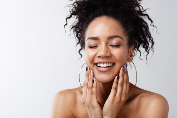 Echo: A generic photo of a woman with glowing skin smiling and touching her face. See PA Feature WELLBEING Vegetarian. Picture credit should read: PA Photo/thinkstockphotos. WARNING: This picture must only be used to accompany PA Feature WELLBEING Vegetarian
