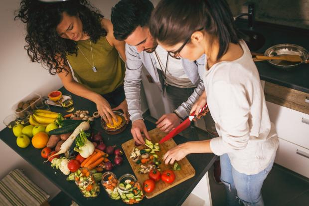 Echo: A generic photo of a group of friends at the  kitchen preparing together vegetarian meal. See PA Feature WELLBEING Vegetarian. Picture credit should read: PA Photo/thinkstockphotos. WARNING: This picture must only be used to accompany PA Feature WELLBEING