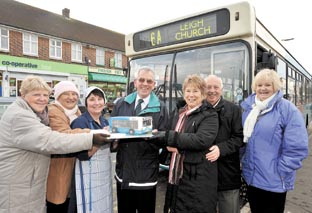 Celebrating  – driver Mike English and his some of his regular passengers