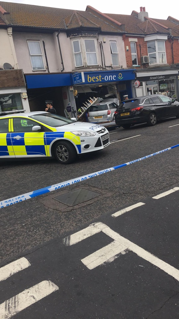 Police cordon in place after car crashes into shop