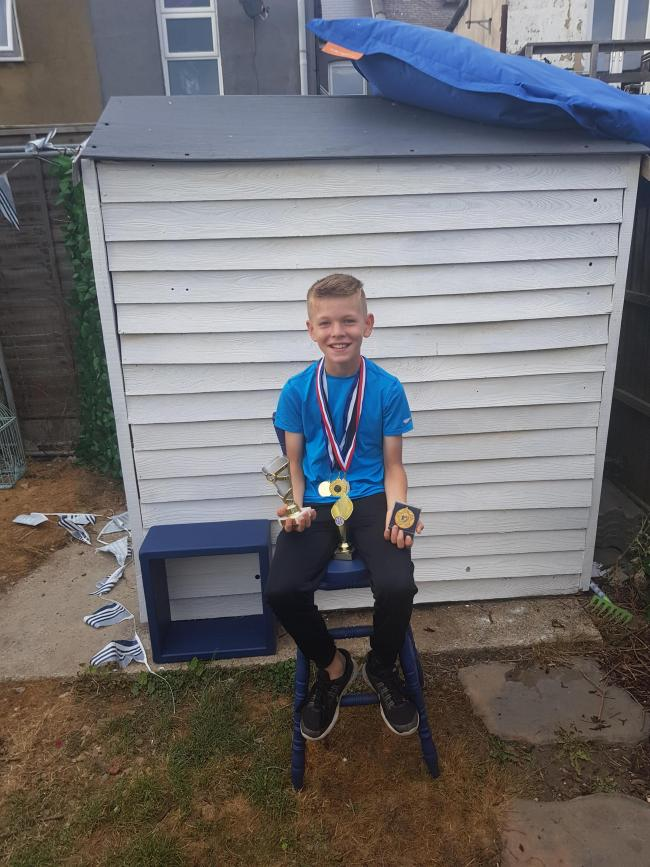 Talented athlete - Harry Wright with some of his awards
