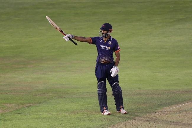Salute - Essex's Varun Chopra raises his bat to celebrate reaching his 50 at Glamorgan in the Vitality T20 Blast, in Cardiff Picture: TGS PHOTO/GAVIN ELLIS