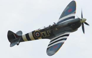 Stunning - the Grace Spitfire, piloted by the world's only female Spitfire pilot Carolyn Grace, flies over the ceremony