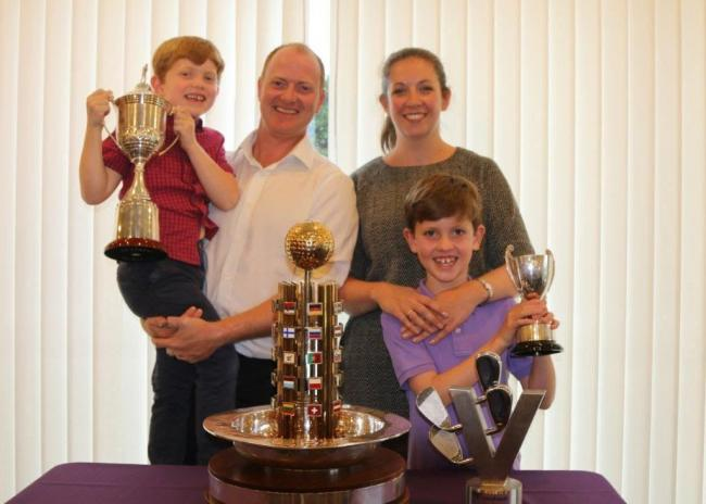 Pleased - Richard McEvoy and his family pose with the numerous trophies Picture: CHRIS RIDGWELL