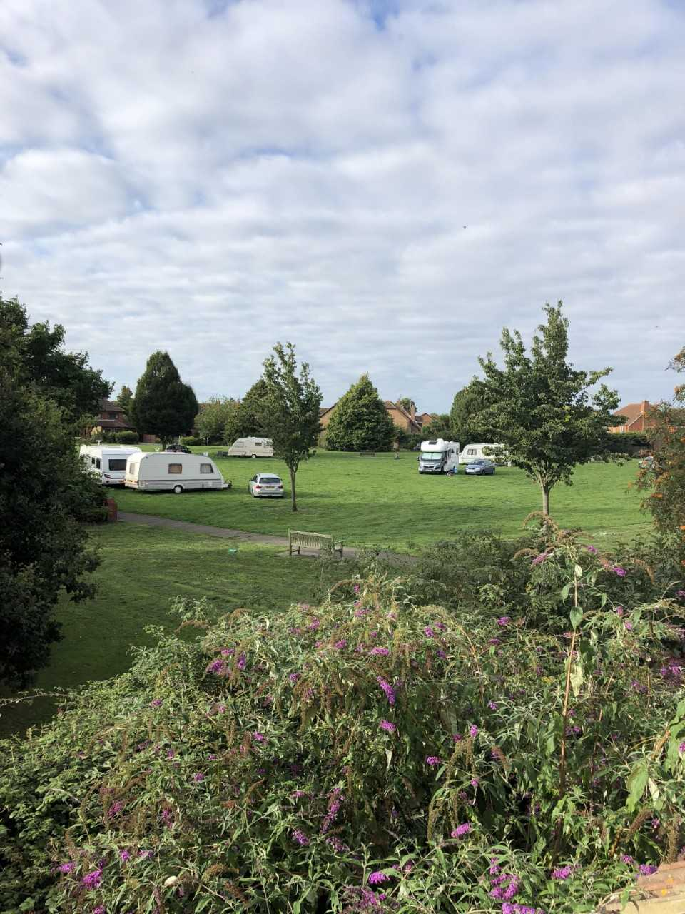 Travellers pitch up on small green next to A13