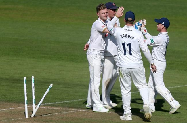 Essex's Sam Cook is congratulated on taking the wicket of Jade Dernbach Picture: TGS Photo