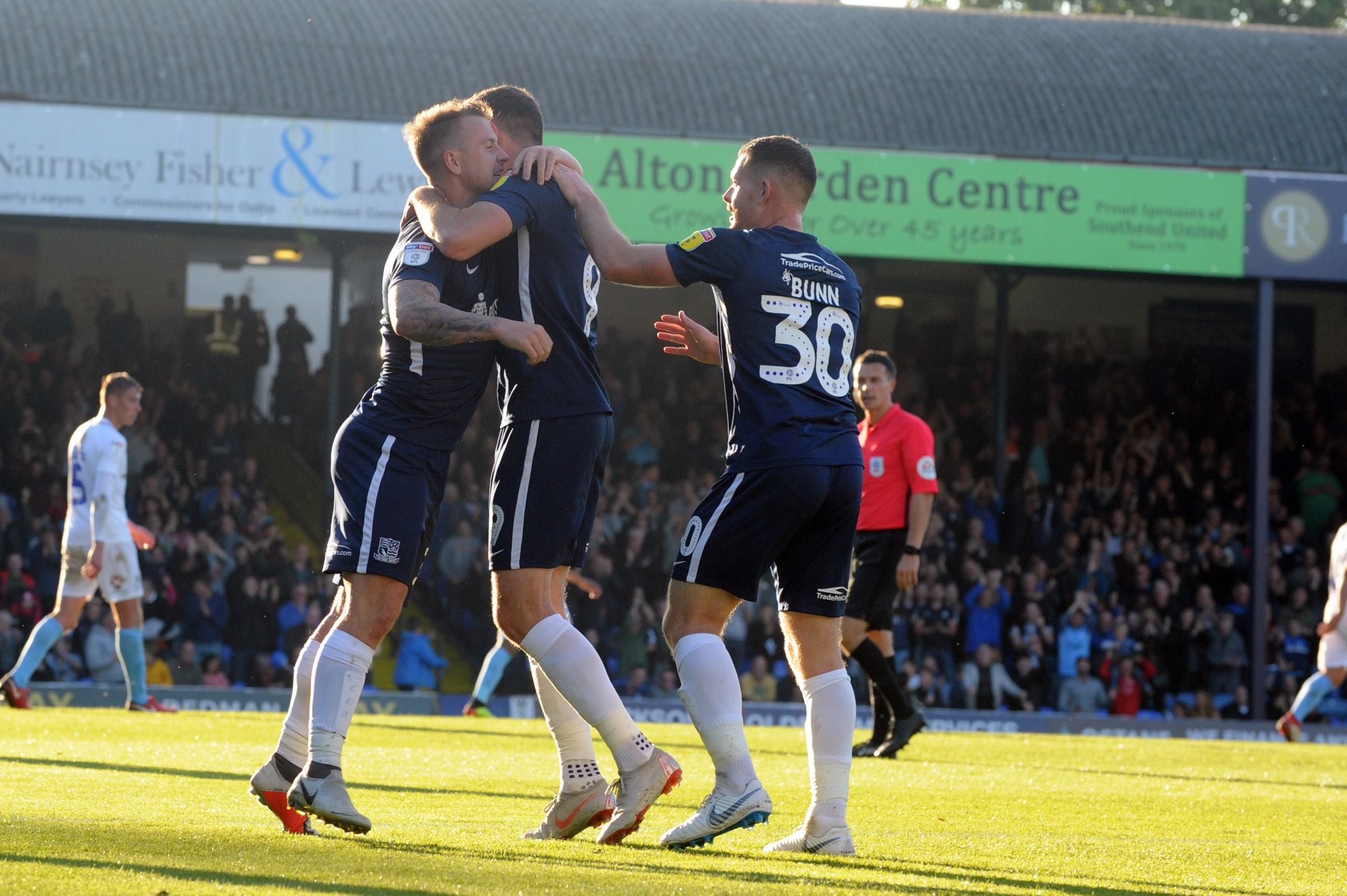 Get in - Tom Hopper is congratulated on his goal