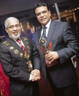 Siraj Ali receives his award from mayor of Tower Hamlets, Abdullah Salique