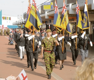 Royal British Legion members lead the procession
