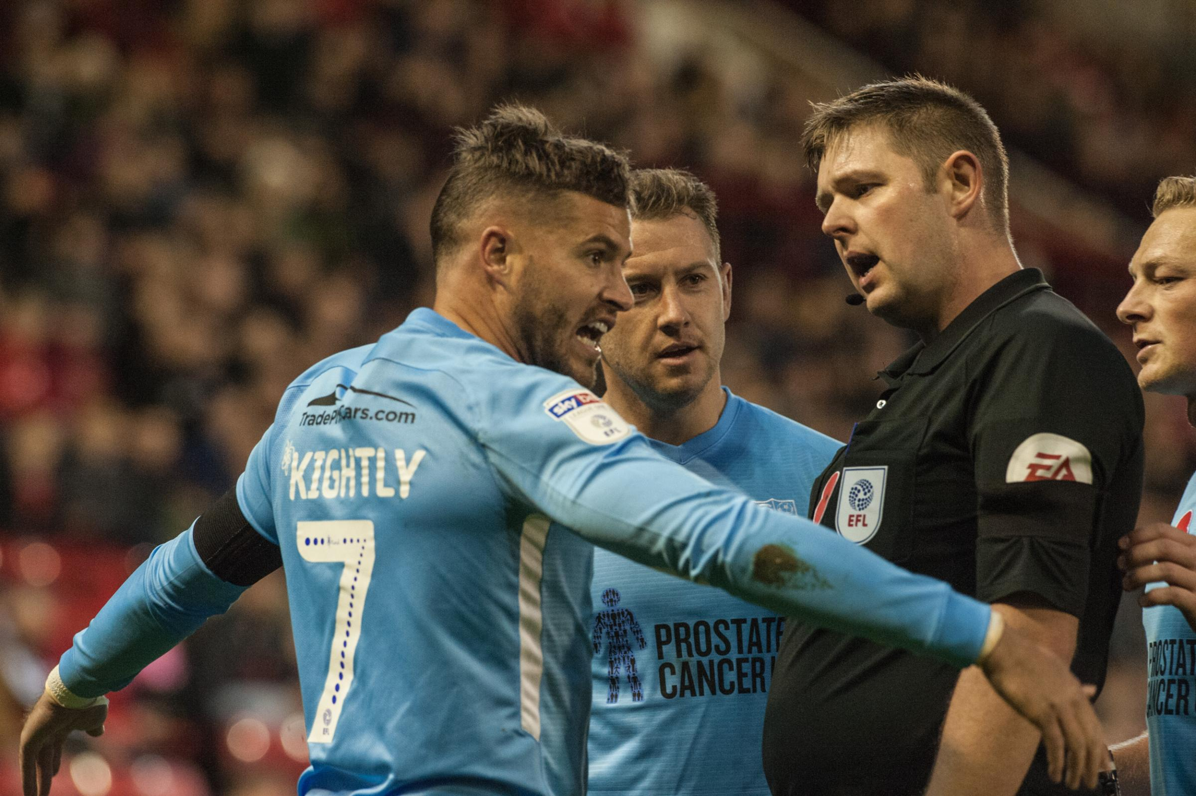 Having his say - Blues winger Michael Kightly speaks with referee Brett Huxtable