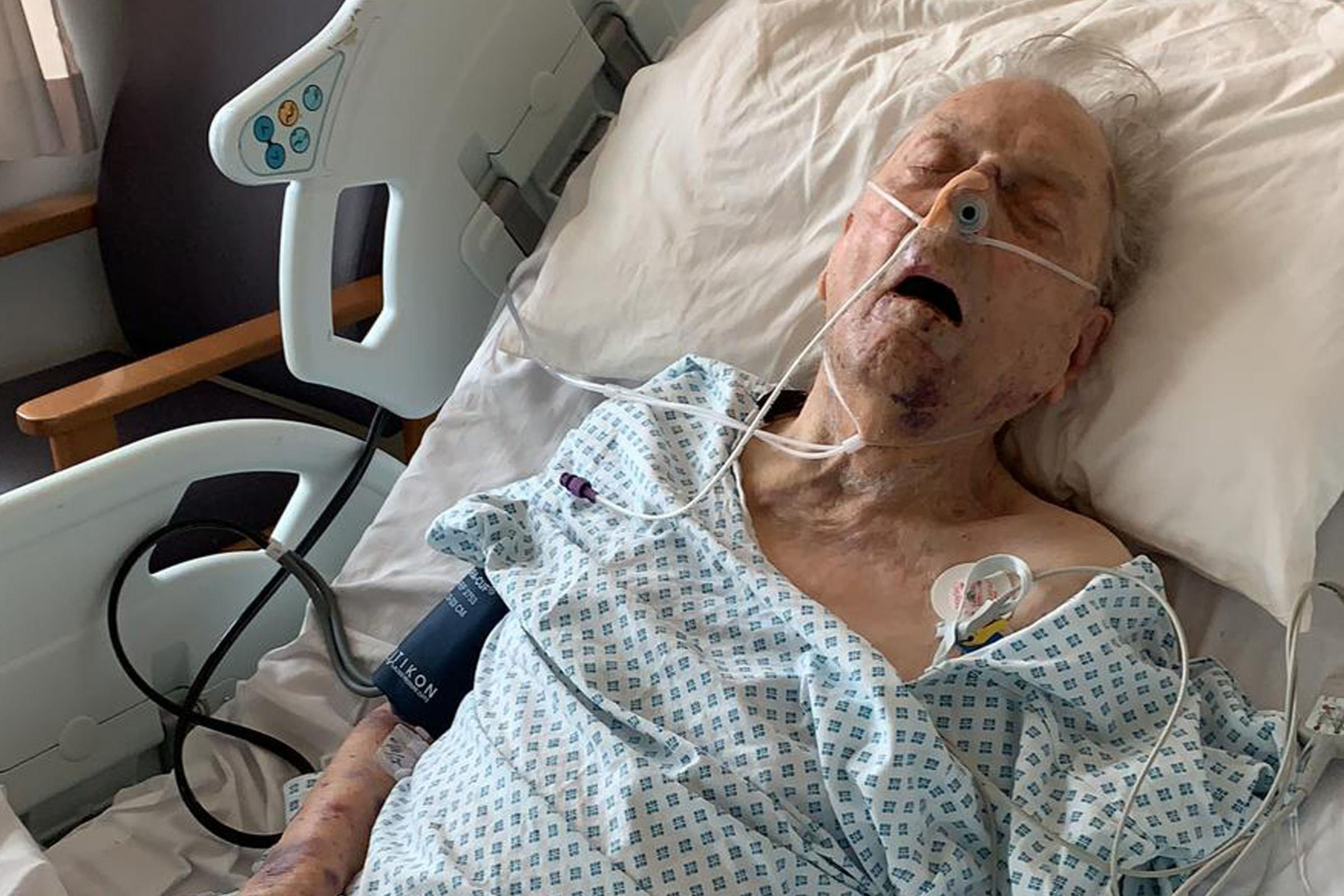 Peter Gouldstone in a hospital bed