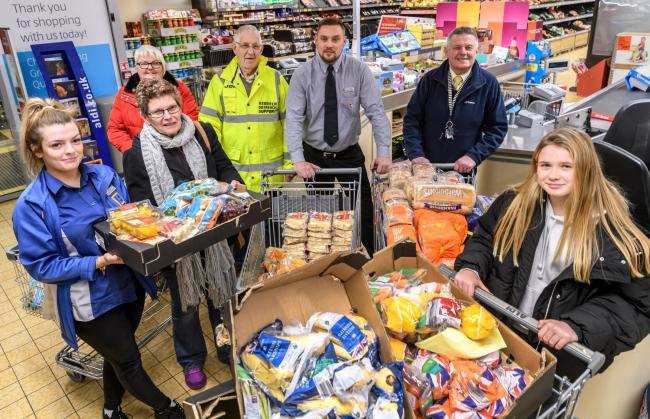 Cheer - Aldi staff with meal donations to give to charities on Christmas Eve