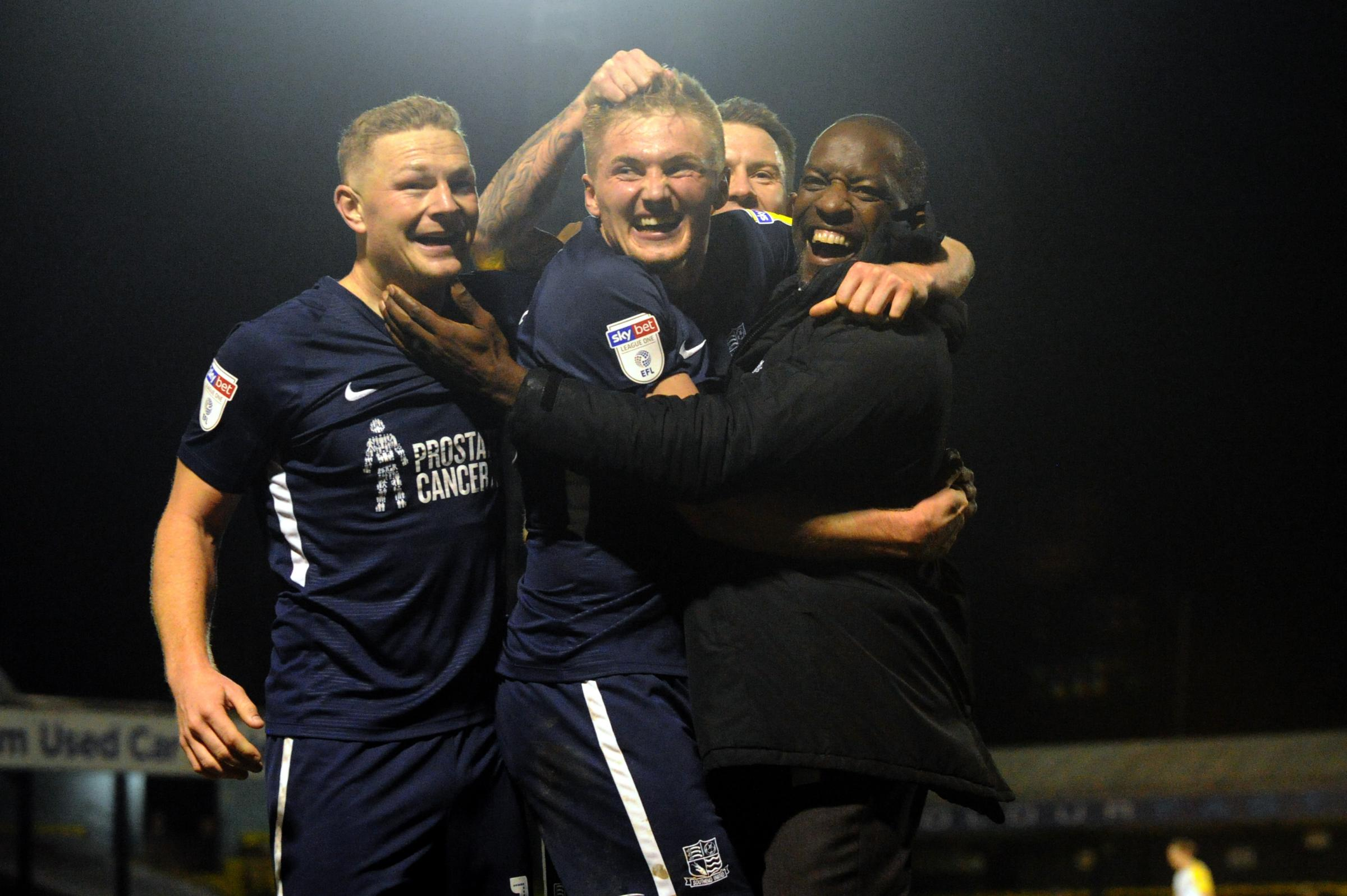 Well done - Taylor Moore is congratulated by Blues boss Chris Powell and his team-mates