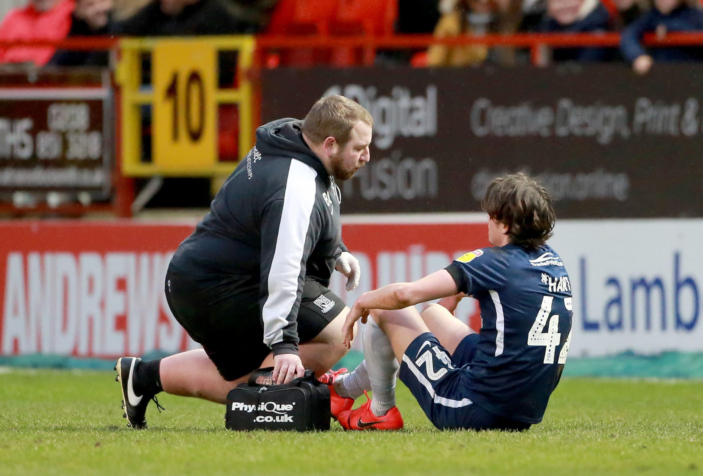 Injured - Southend United Sam Hart is treated by Blues physio Ben Clarkson