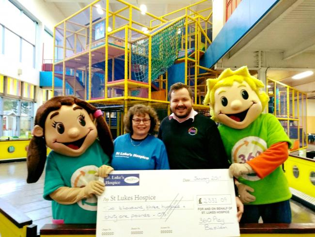 Donation - staff from the play centre and hospice with the mascots