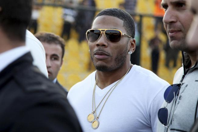 FILE- In this March 13, 2015 file photo, rapper Nelly approaches the stage for a concert in Irbil, northern Iraq.  The St. Louis-based rapper is asking the federal court in his hometown to dismiss a British woman's lawsuit alleging that he sexually