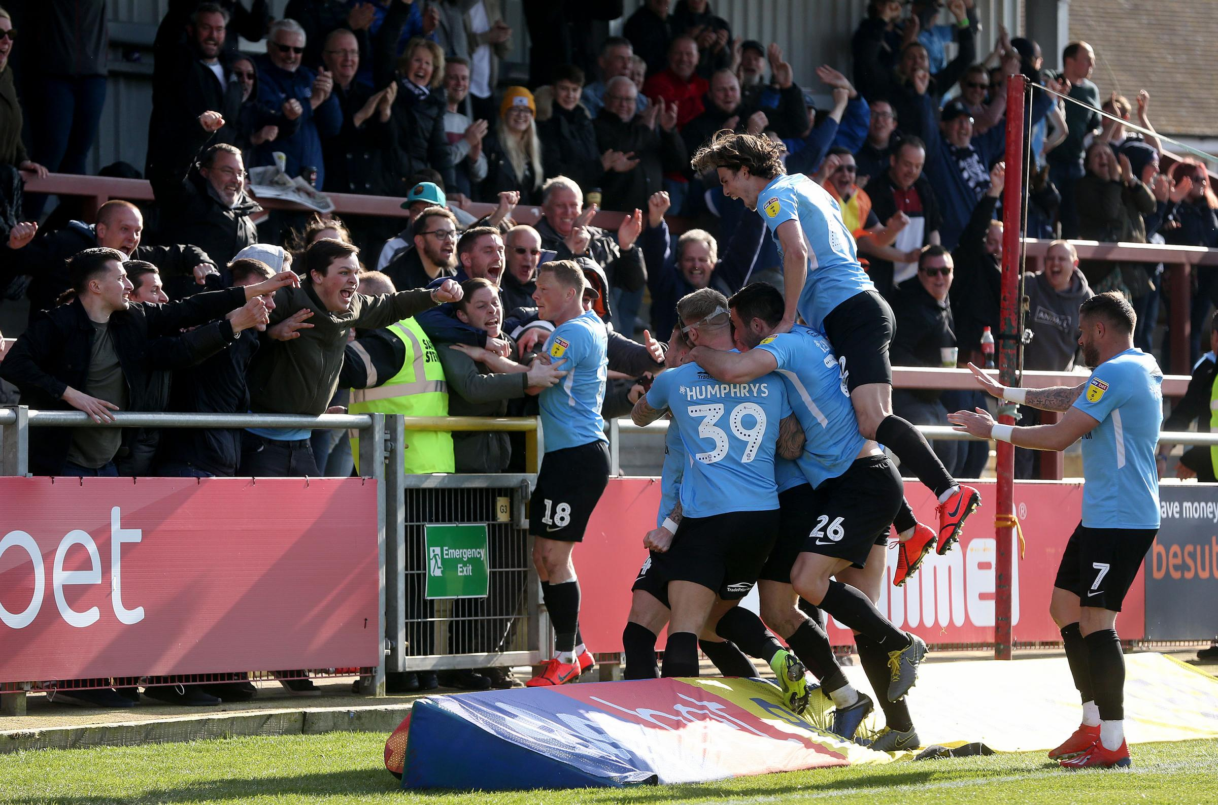Get in - Southend United's players celebrate Luke Hyam's goal