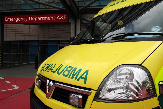 An ambulance outside the entrance to an A&E department