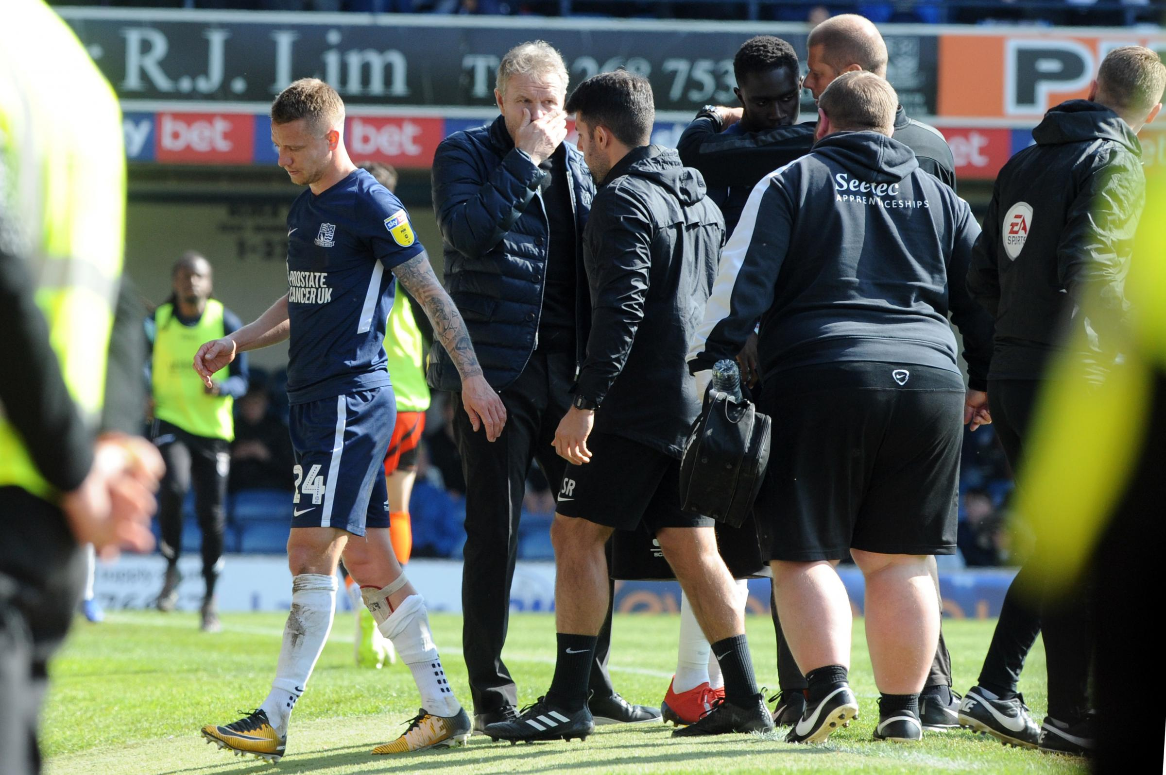 Another blow - Jason Demetriou went off injured for Blues against Wycombe Wanderers
