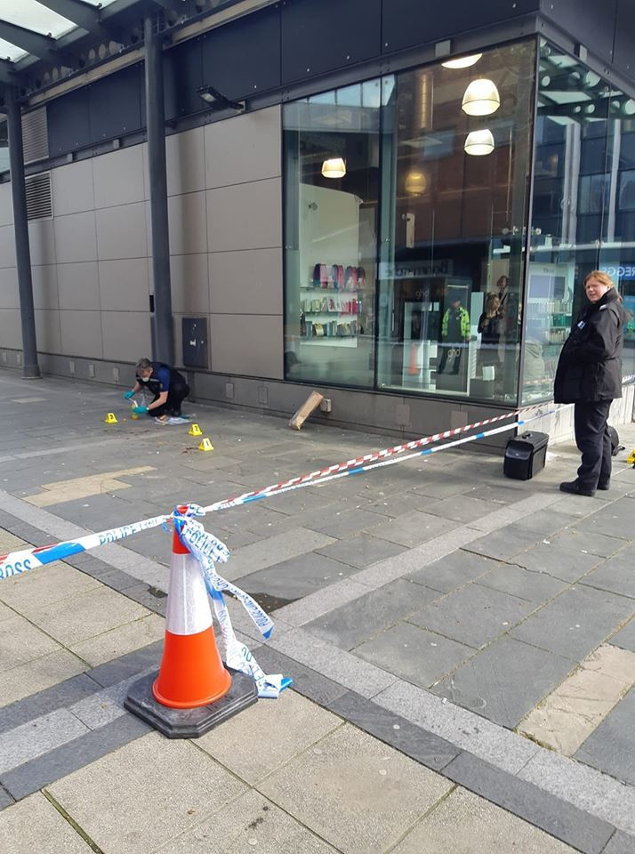 Cordon - police forensic teams in Basildon Town Square after the attack on John Hickson