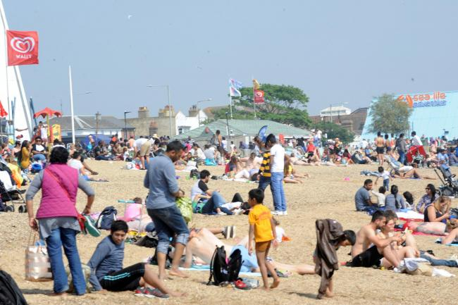 Sunny - people enjoying the sun on Southend beach. Temperatures could top 20°C this weekend