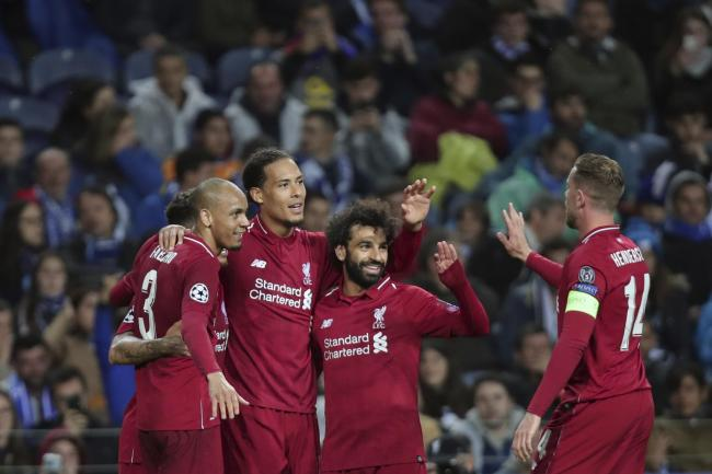 Liverpool's Virgil Van Dijk celebrates with teammates