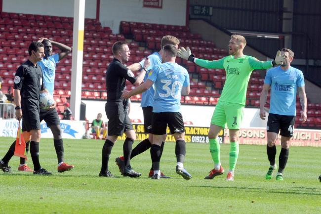 Angry - Blues' players protest to referee Ross Joyce