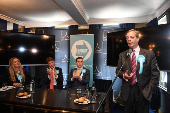 Brexit Party leader Nigel Farage with Brexit Party chairman Richard Tice (second left) and candidates Michael Heaver and June Mummeryat the SugarHut in Brentwood, Essex while on the European election campaign trail. PRESS ASSOCIATION Photo. Picture dat