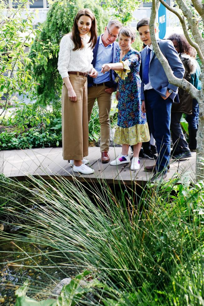 The Duchess of Cambridge (L) with designers Adam White (2L) and Andree Davies (2R) on the RHS Back to Nature Garden, which she designed with landscape architects Andree Davies and Adam White of Davies White Landscape Architects. RHS Chelsea Flower Show 20