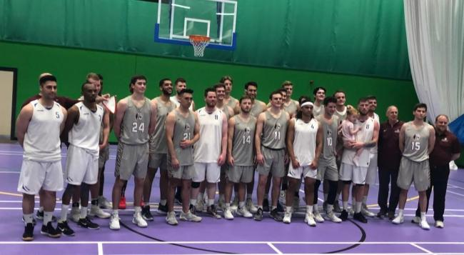 On court - a Texas University basketball team line up with the Southend Scorpions