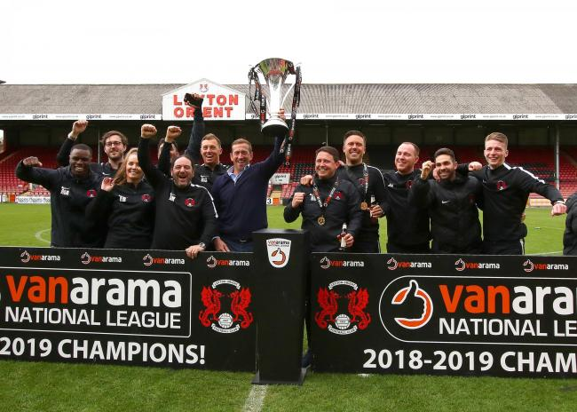 Success - Justin Edinburgh holds aloft the National League trophy